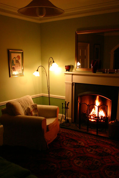 The sitting room - cosy by the fire